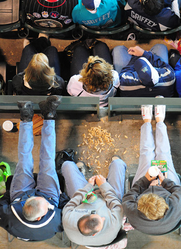 Fans enjoy peanuts while watching the Mariner's 3-2 win over the Arizona Diamondbacks to sweep the series Sunday June 21, 2009. Photo by Daniel Berman/SeattlePI.com