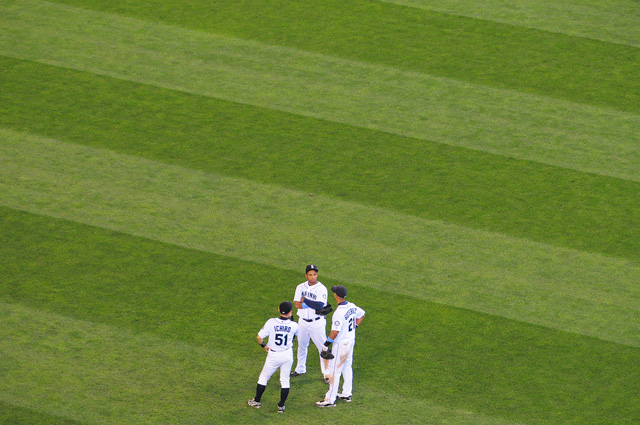 The Mariner's outfield meets during the 7th inning during a pitching change by the Arizona Diamondbacks Sunday June 21, 2009. Photo by Daniel Berman/SeattlePI.com