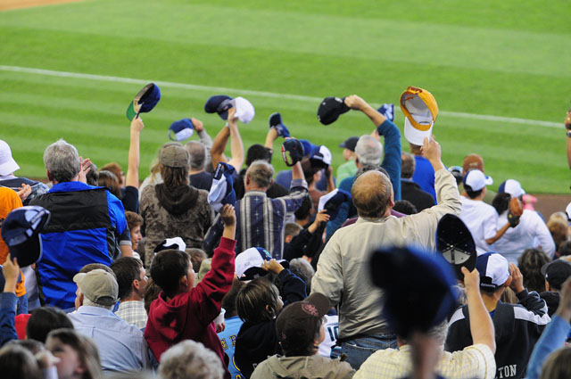 Fans wave their hats to celebrate a single by Ichiro Suzuki in the 7th inning of the Mariner's 3-2 win over the Arizona Diamondbacks to sweep the series Sunday June 21, 2009. Photo by Daniel Berman/SeattlePI.com