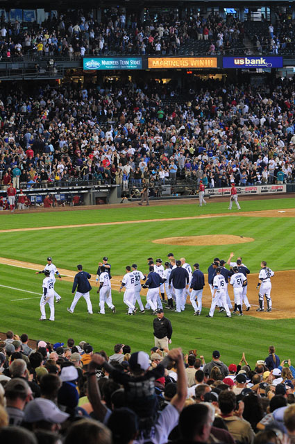 The Mariners gather on field to celebrate after defeating the Arizona Diamondbacks 3-2 to sweep the series Sunday June 21, 2009. Photo by Daniel Berman/SeattlePI.com