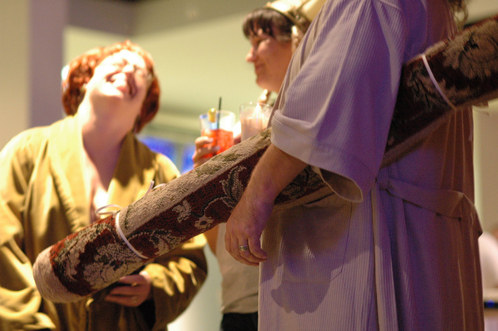 "A ""The Big Lebowski"" fan carries a rolled-up rug during Lebowski Fest at Acme Bowl in Tukwila Tuesday July 21, 2009. Photo by Daniel Berman/SeattlePI.com"