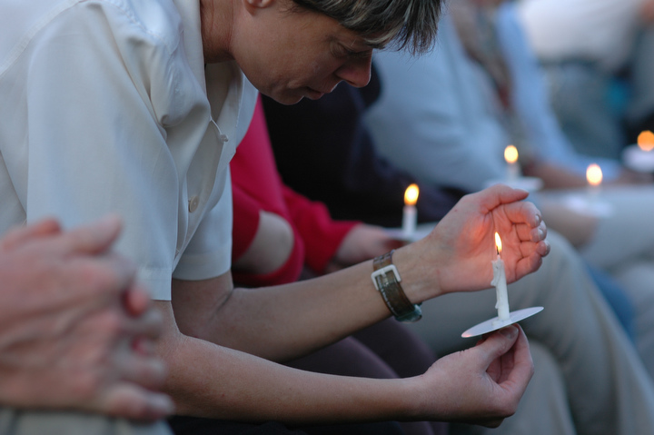 "Tash Blackburn of Bellingham works to keep her candle'[s flame alive during a candle light vigil for the victim of a stabbing early last week at the South Park Community Center in south Seattle Thursday July 23, 2009. Blackburn worked with the victim and said she was ""genuine, inside and out."" Photo by Daniel Berman/SeattlePI.com"