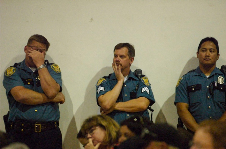 Seattle Police Department Southwest Precinct officers listen during a public meeting to discuss the stabbing of an area resident and crime in the area, at the South Park Community Center in Seattle Monday July 20, 2009. Photo by Daniel Berman/SeattlePI.com