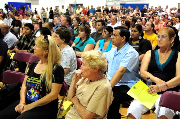 South Park residents listen during public meeting to discuss the stabbing of an area resident and crime in the area, at the South Park Community Center in Seattle Monday July 20, 2009. Photo by Daniel Berman/SeattlePI.com