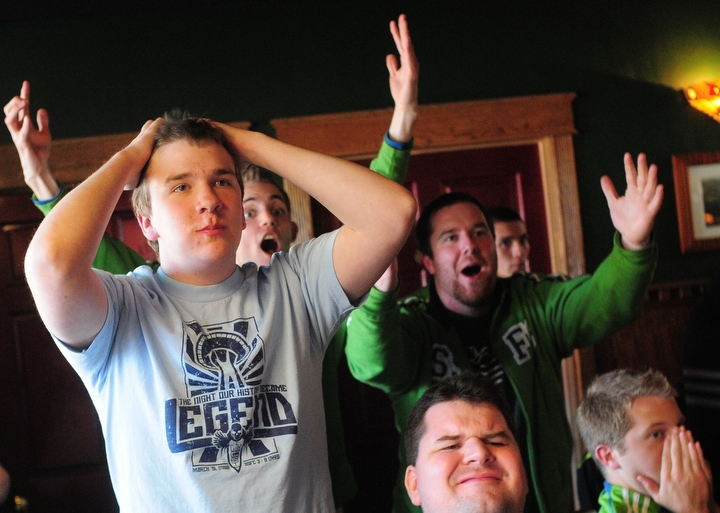 Sounders fans show their frustration as Dallas scores their second goal, during a meet-up of the Bellingham Border Boys at McKay's Taphouse to watch the Sounders tie Dallas FC 2-2 Thursday April 22, 2010. The fans are (l-r) Erik Roeser, Eric Hoedel (in blue), Bill Kristian (in back), Ben Fox, Brian Babcock and Derek Johnson. Photo by Daniel Berman.