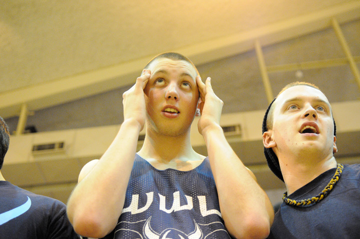 A fan cringes in the final seconds of Western's 66-62 victory over rival Central Washington University Wednesday, Feb. 16. Photo by Seattle Bellingham photographer Daniel Berman/www.bermanphotos.com