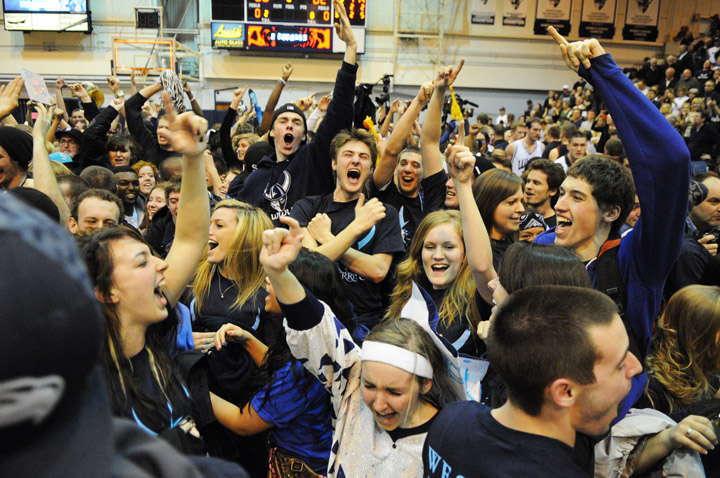 Western Washington University fans celebrate after a 66-62 victory over rival Central Washington University Wednesday, Feb. 16 at Carver Gym in Bellingham, Wash. Photo by Daniel Berman/www.bermanphotos.com