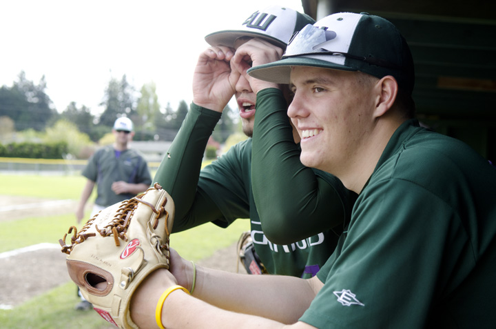 Edmonds-Woodway outfielders Troy Rheinford, center, and Mac McLachlan horse around while waiting out a game delay before their  6-1 victory over Arlington High Saturday, May 5 in Edmonds. Photo by Daniel Berman/for the Daily Herald