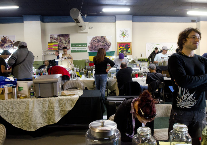 Patients and vendors at the NW Cannabis Market in Seattle, Washington mingle and donate medical cannabis and edibles to each other May 22, 2012. The market serves a few hundred medical marijuana patients on a daily basis. Photo by Daniel Berman