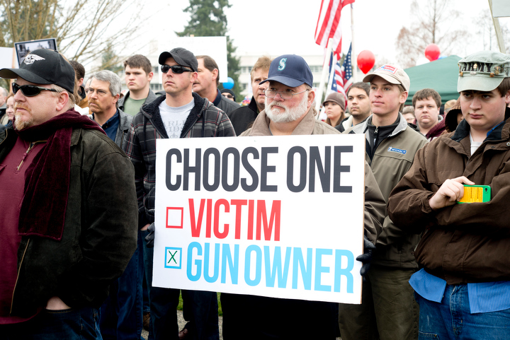 About 1,500 gun owners and supporters attended the Guns Across America rally at the Washington State Capitol in Olympia Saturday, Jan. 19, 2013. The organization held events at capitol buildings in many states to show support for the 2nd Amendment and opposition to new gun control measures. Photo by Daniel Berman/www.bermanphotos.com