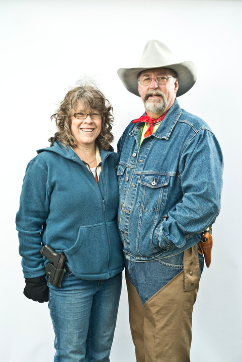 "Carrie Mann and her husband, Craig, of Belfair, were two of about 1,500 gun owners and supporters to attend the Guns Across America rally at the Washington State Capitol in Olympia Saturday, Jan. 19, 2013. Carrie brought her 380 Millenium Taurus .380 ACP Pistol, and Craig brought his .357 S&W Magnum. ""We just support open carry laws and want to support the rights of this state's constitution and our country's constitution,"" said Craig, a member of the Washington state Constitutional Party. Photo by Daniel Berman/www.bermanphotos.com"