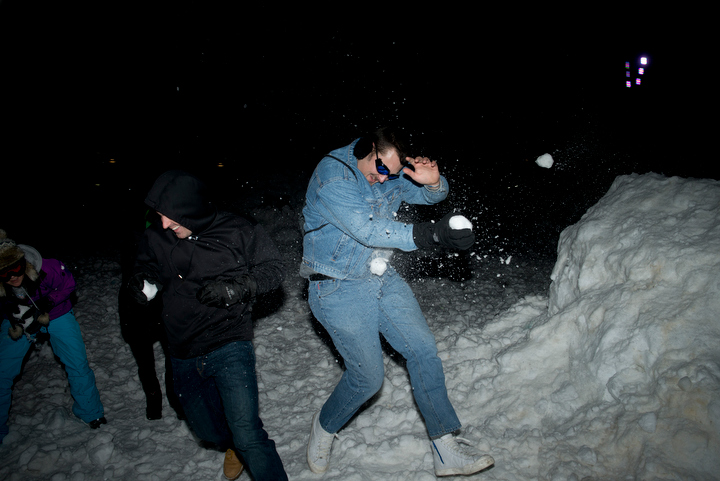 Brave people running between the various snow forts try to protect their head and face from incoming snowballs. Photo by Daniel Berman/www.bermanphotos.com