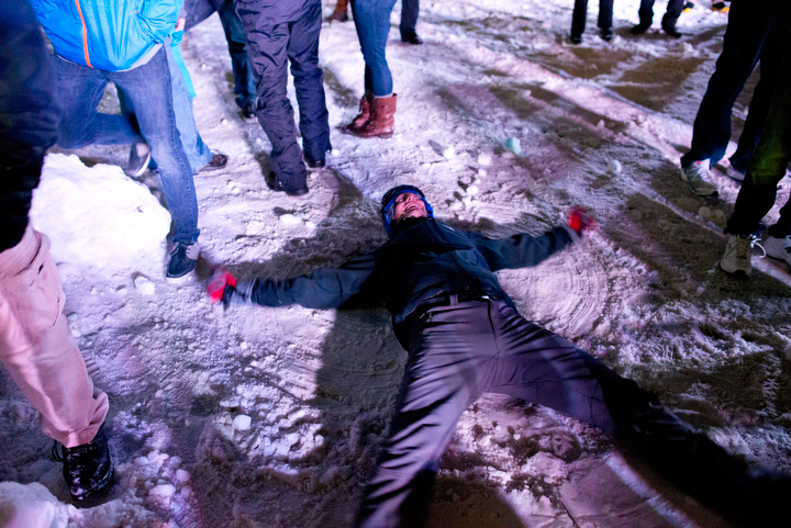 An event participant makes a snow angel after officials from the Guinness Book of World records certified that 5,387 people took part in Seattle Snow Day, enough to break the record for biggest snowball fight. Photo by Daniel Berman/www.bermanphotos.com