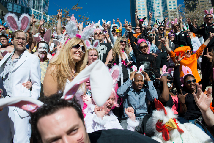Dozens dressed like bunnies for a cross-town pub crawl during Bunnycon 2013 in Seattle Saturday March 30, 2013, which included a stop at Harbor Steps for a group photo.