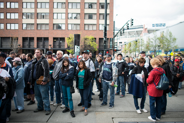 Seattle Mariners fans wait in line before entry gates opened three hours before gametime. The Seattle Mariners defeated the Houston Astros 3-0 during Opening Day at Safeco Field Monday April 8, 2013. Photo by Daniel Berman/www.bermanphotos.com