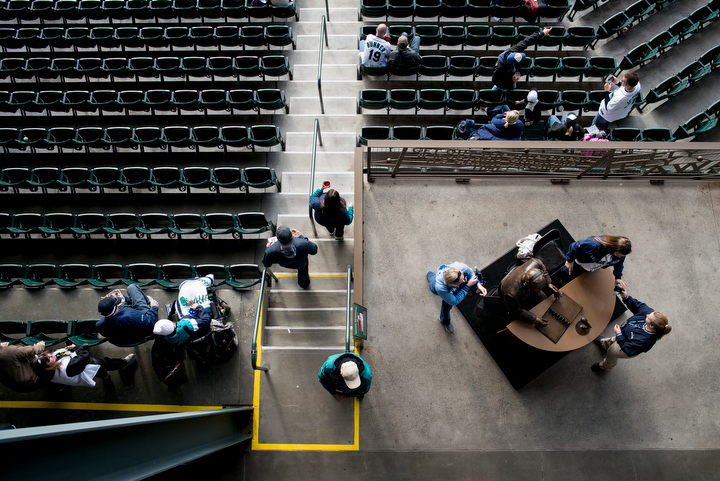 Fans work to find their seats in the 200 level of the outfield before the start of the game. The Seattle Mariners defeated the Houston Astros 3-0 during Opening Day at Safeco Field Monday April 8, 2013. Photo by Daniel Berman/www.bermanphotos.com