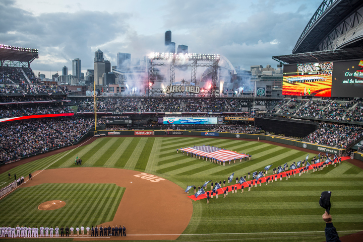 Fireworks are launched during the national anthem. The Seattle Mariners defeated the Houston Astros 3-0 during Opening Day at Safeco Field Monday April 8, 2013. Photo by Daniel Berman/www.bermanphotos.com