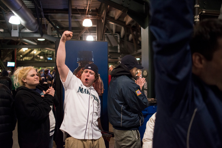 At the end of the game, a fan celebrates the team's victory. The Seattle Mariners defeated the Houston Astros 3-0 during Opening Day at Safeco Field Monday April 8, 2013. Photo by Daniel Berman/www.bermanphotos.com