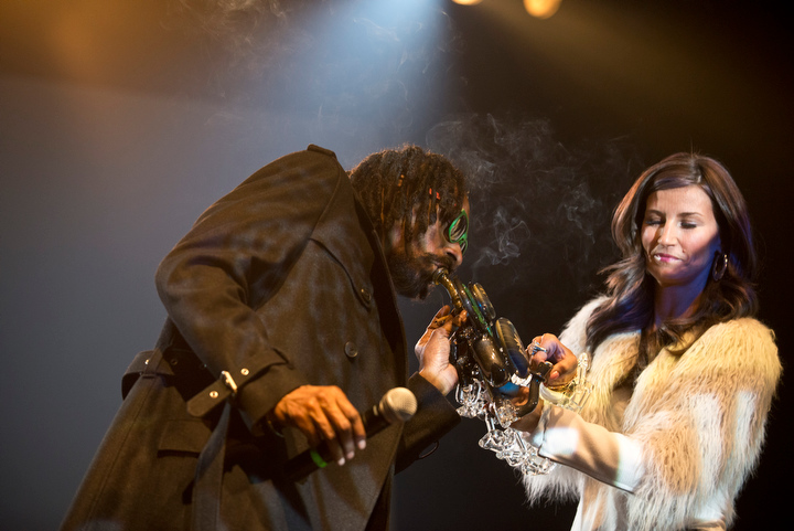 High Times gave Snoop Lion a lifetime achievement award during the raucous, smoke-filled evening, and he wasted little time smoking from his trophy.